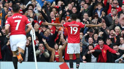 MANCHESTER, ENGLAND - MARCH 10:  Marcus Rashford of Manchester United celebrates scoring their second goal during the Premier League match between Manchester United and Liverpool at Old Trafford on March 10, 2018 in Manchester, England.  (Photo by Matthew Peters/Man Utd via Getty Images)