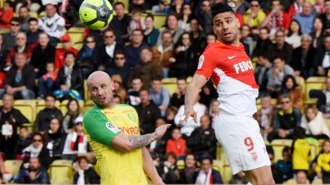 Soccer Football - Ligue 1 - AS Monaco vs FC Nantes - Stade Louis II, Monaco - April 7, 2018  Monaco's Radamel Falcao in action with Nantes' Nicolas Pallois   REUTERS/Jean-Pierre Amet